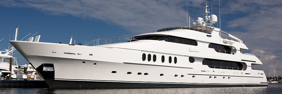 large white private mega yacht alongside dock: yacht restoration, brendel restoration